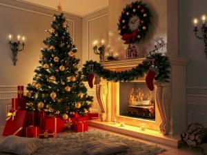 christmas tree with presents garland and wreath around a fireplace